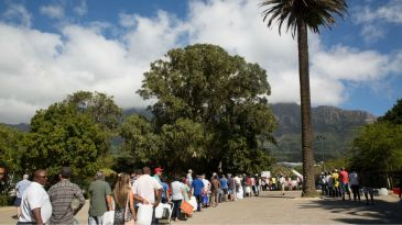 South Africans wait for water in Cape Town in March 2018. Photo via Shutterstock.com